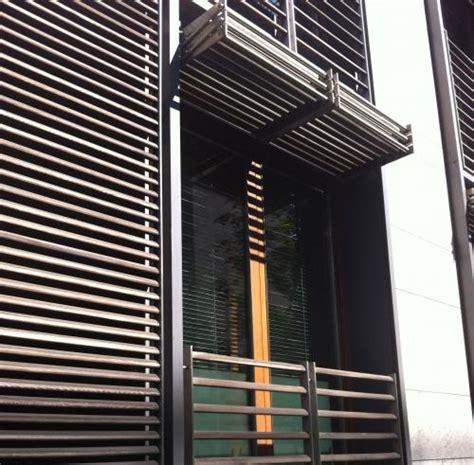 berlin vertical folding sliding louvered shutter