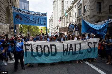 Thousands descend on Wall Street to protest climate change ...