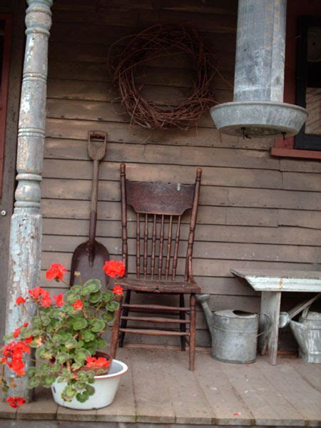 Weathered Porch Old Chair Watering Can Idea