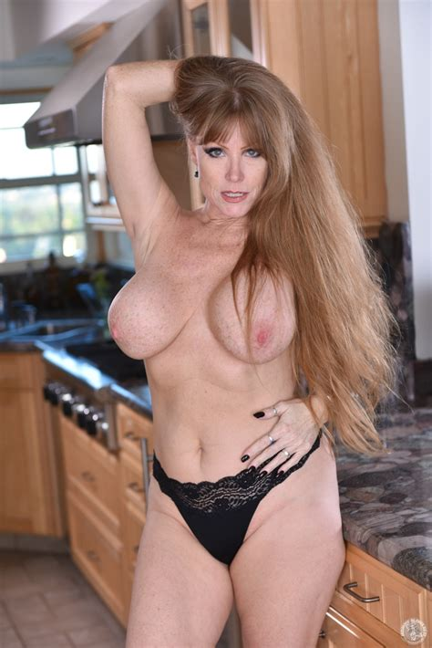 hot milf is busy in the kitchen