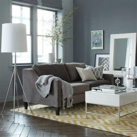 wall color gray couch yellow rug living room