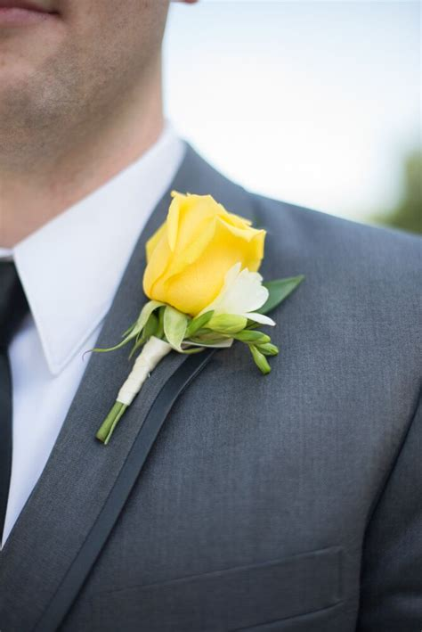 yellow rose  freesia boutonniere