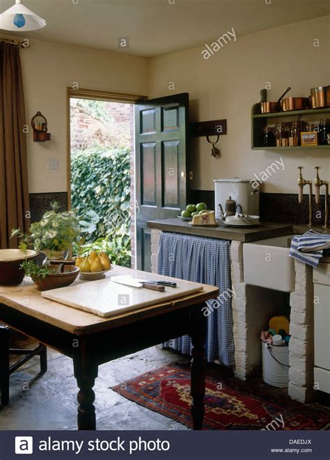 country cottage kitchen images wooden table in center rustic country cottage kitchen with 5957