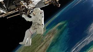 Astronaut Outside The International Space Station On A ...