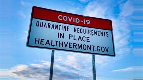 Signs warn visitors of Vermont quarantining requirements
