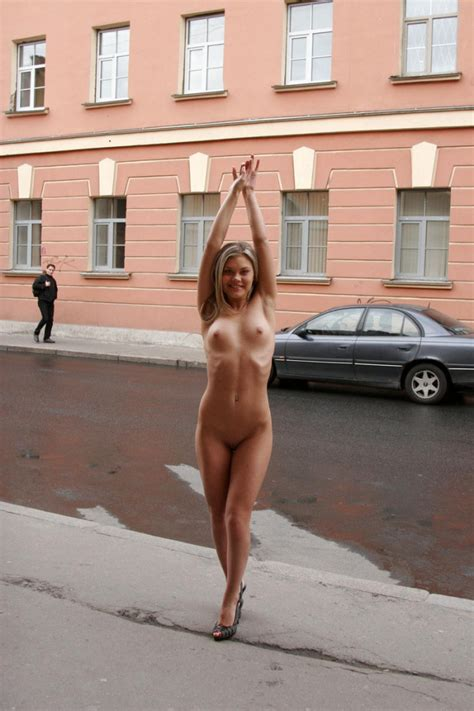Nude Blonde Walking Along The Streets In The Early Morning