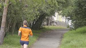 Close Up Of Man Running In The Woods Stock Footage Video ...
