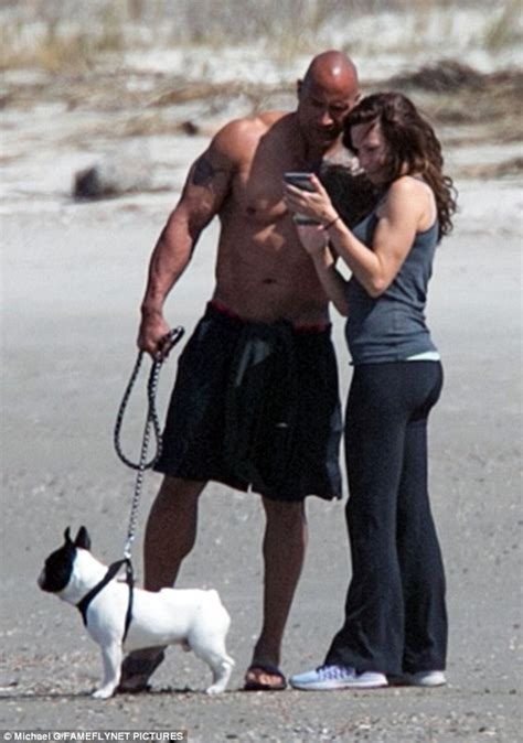 dwayne johnson the rock bikini dwayne the rock johnson enjoys beach stroll with