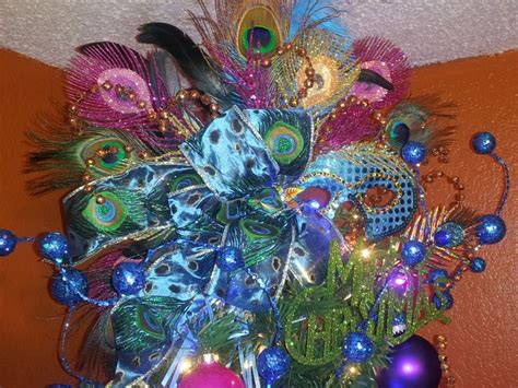 my one of a kind peacock tree topper decorated for a