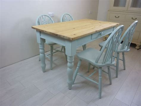 pine farmhouse table and 4 wheelback chairs painted