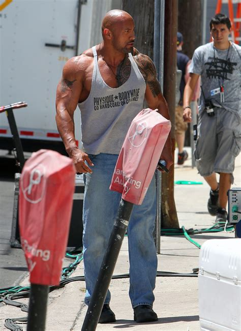 dwayne johnson shows   huge muscle zimbio