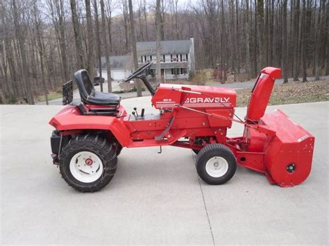 gravely 20 g with 48 quot snowblower and chains tractors