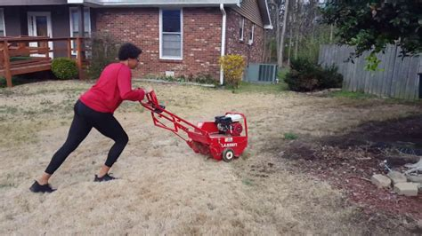 Aerating The Front Lawn With An Aerator From Home Depot