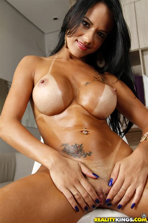 Brazilian babe Liandra Andrade playing with big breasts in ...