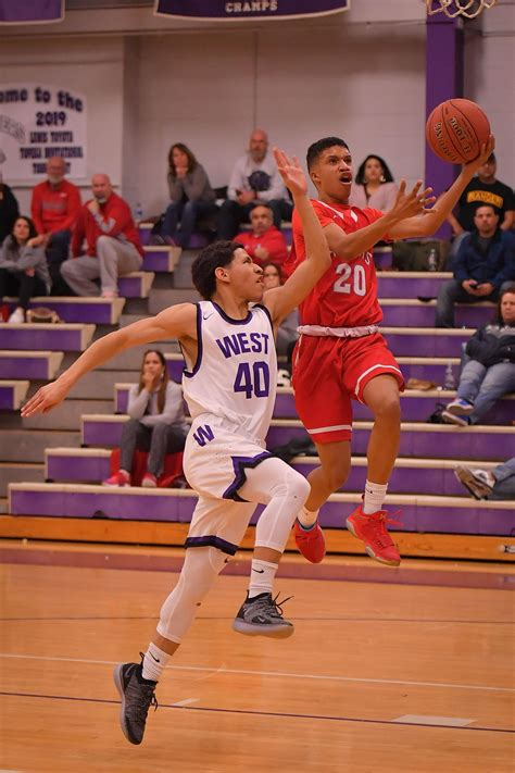 heights boys rally late     win  city rival