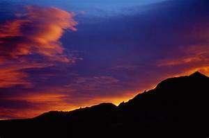 Pictures Of Sunsets Over Mountains