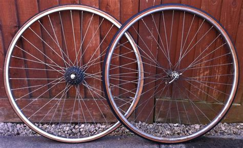 For Sale: 700c wheels, new conti tyres, arm warmers, tubes ...