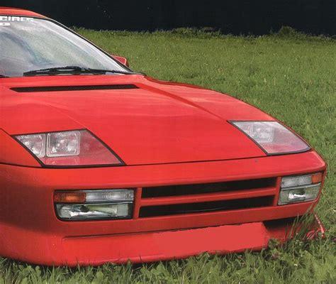 Ten iconic cars with concealed headlights. Testarossa headlights