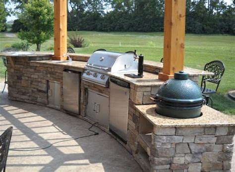outdoor kitchen with big green egg golf course in the background of this beautiful open 9025
