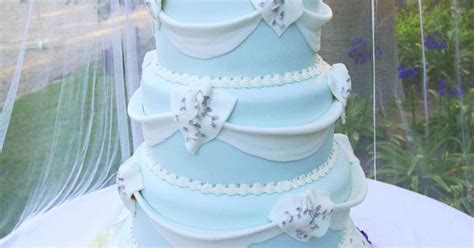 Wedding Cake With Light Blue Frosting, White Accents And A