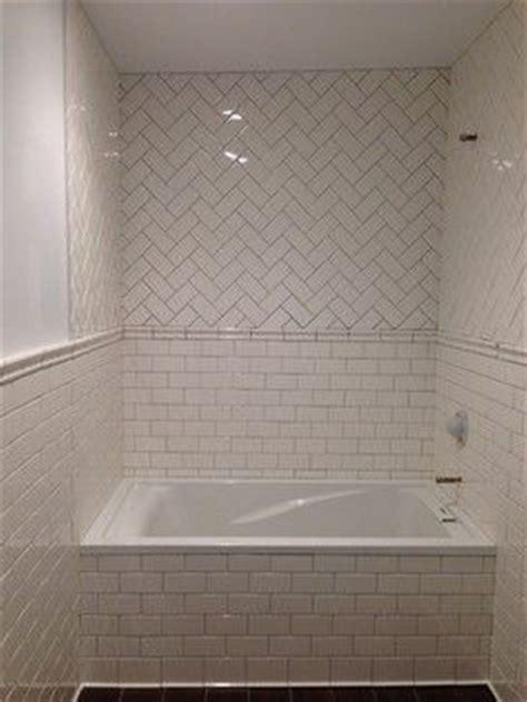 herringbone traditional bathroom and traditional on