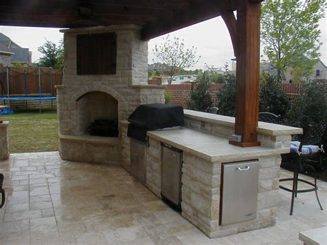 outdoor fireplace with covered tv connects to outdoor