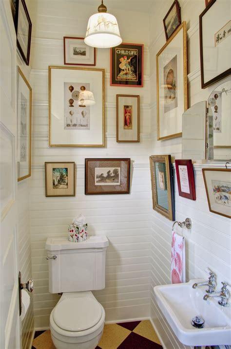 It's a quick and easy diy bathroom decor idea that can immediately transform your bathroom. gallery wall, bathroom art, eclectic, art display, how to hang art, powder room | Bathroom wall ...