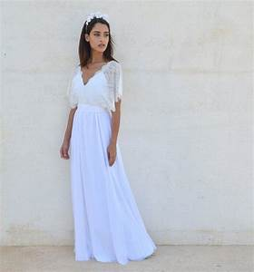 Bohemian wedding dress v neck cleavage from barzelai dresses for Wedding dress cleavage