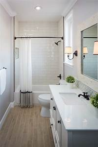 Guest bathroom with wood grain tile floor, subway tile in