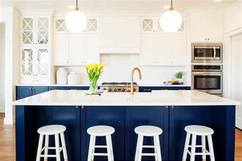 blue and white kitchen cabinets white and navy blue kitchen features white upper cabinets
