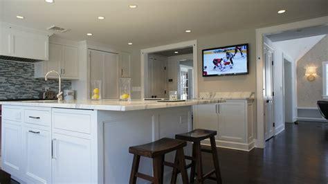 Cari's Newly Remodeled Kitchen (& Baths!)  Hooked On Houses. Light Oak Cabinets. Black Sideboard. Supreme White Granite. How To Decorate Bookshelves. Copper Backsplash. Distressed Area Rug. Herringbone Stair Runner. Waterproof Paint For Shower