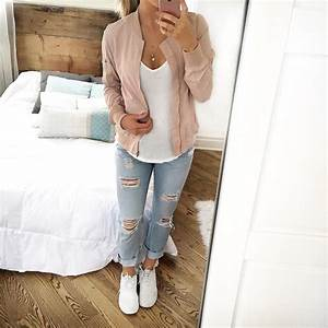 Blush pink bomber jacket over white tee, light wash ripped ...