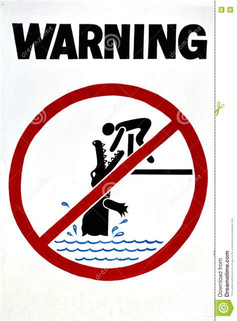 warning sign danger crocodiles no swimming stock photo