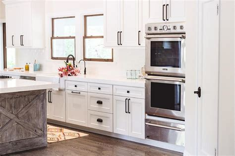 white kitchen cabinets with rubbed bronze hardware rubbed bronze cabinet pulls cosmas rubbed bronze 2261