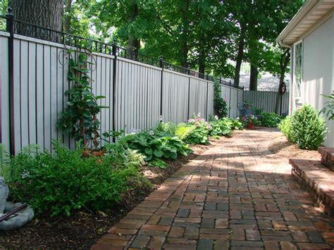 landscaping fences landscaping along fence and pavers outdoor spaces