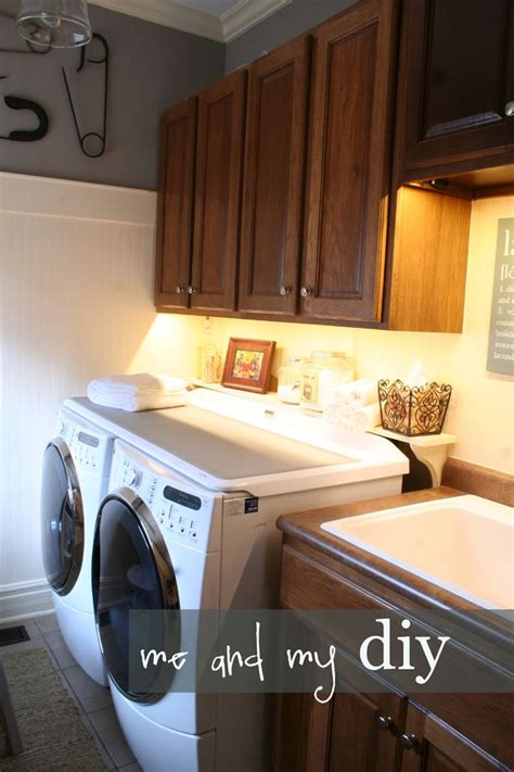 cabinets over washer and dryer laundry room makeover hanging baskets washers and cabinets