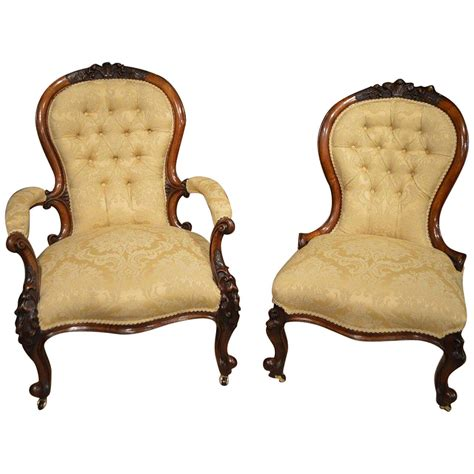 pair of carved and upholstered mahogany wing pair of walnut period antique chairs at 1stdibs