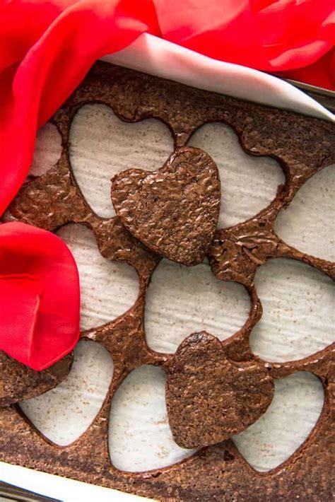 mini brownie layer cakes  raspberry coulis