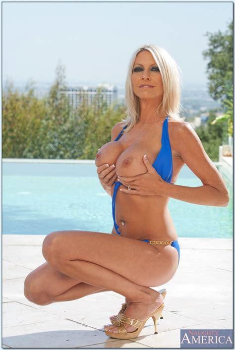 Blonde Milf Slut In A Blue Bikini Turns On A Younger Man