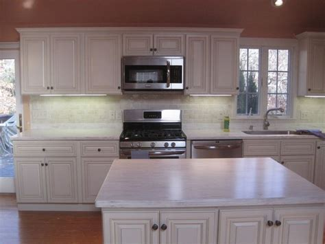 Corian Witch Hazel countertops with undermount stainless