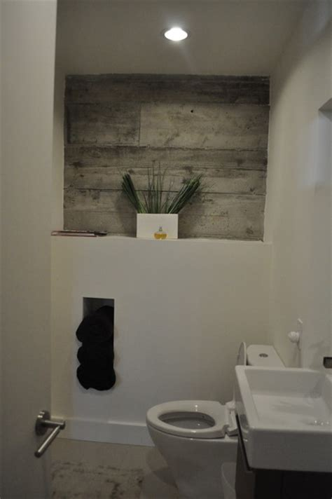 exposed concrete bathroom wall detail