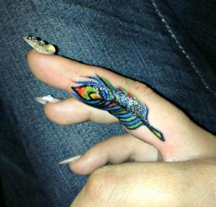 finger small peacock tattoo small peacock tattoos