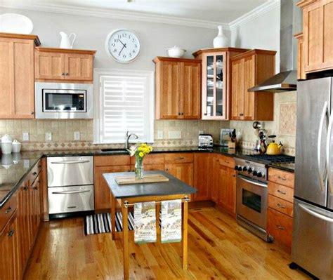 kitchen  wood cabinets wood floor dark countertop