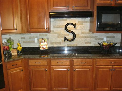 stacked stone backsplash   airstone sold  lowes  lightweight easy