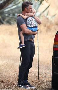 Josh Duhamel cradles son Axl in LA | Daily Mail Online