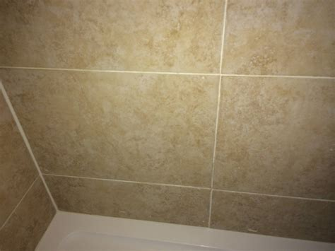 leak how to fix wall side of newly fitted tiles