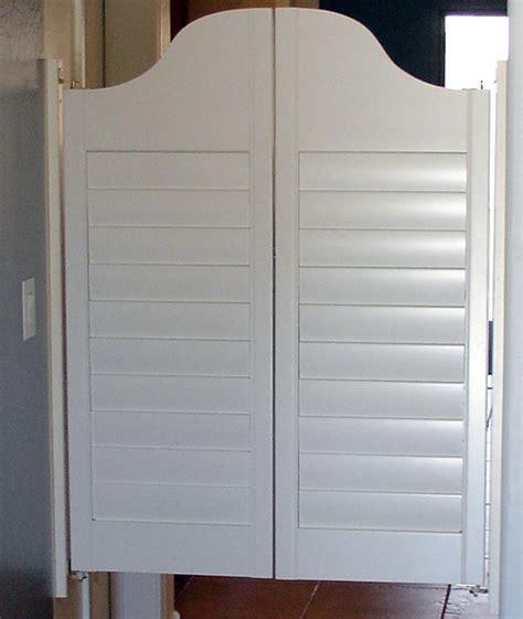 white shutter swinging saloon doors