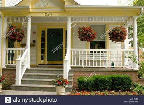 Victorian Front Porch With Potted Hanging Plants Stock