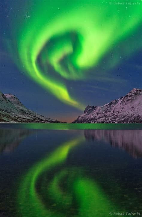 norway march northern lights the northern lights or aurora borealis swirls over a fjord
