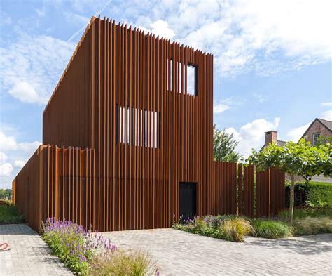corten steel designs rusted steel fins define the interior and exterior of the corten house in belgium corten house